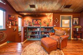 corrugated metal ceiling ideas corrugated ceiling ideas family room southwestern with wood floors trim wall art