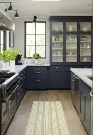 dark gray kitchen with Carrara marble counters and wood floor - Jeanne  Rapone via Atticmag