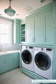 cabinets in laundry room. color spotlight: wythe blue from benjamin moore. teal laundry roomslaundry cabinets in room