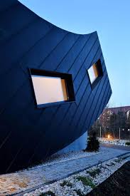 Curved Architecture Small Home Creates Large Statement With Vertically Curved Facade