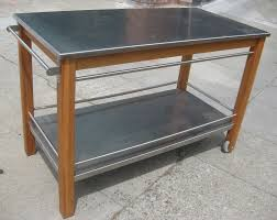 wheeled wooden kitchen cart combined with stainless steel countertop