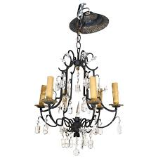small six light wrought iron and crystal chandelier for