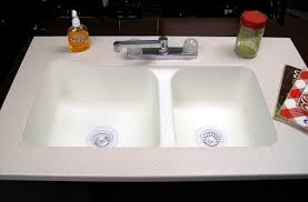 19 x 33 60 40 undermount kitchen sink with a solid surface counter top