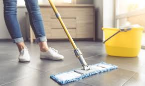 the treatment by mopping the tile floor