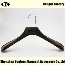 high end wood clothes hanger with metal plate logo