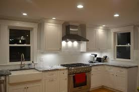 downlights are placed in front of the cabinets in the ceiling