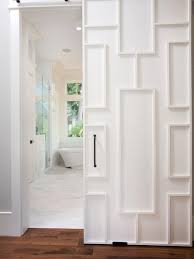 modern white closet doors. gorgeous white fretwork sliding door finished with a oil rubbed bronze handle opens to well appointed contemporary master bathroom. modern closet doors i