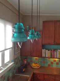 in our glass insulator pendant lights that were seen in the photos also i promised in my last blog post that i would talk about how they came to be