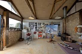 art studio lighting design. art studio with rustic wastebaskets home office and paintings lighting design