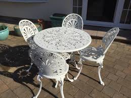 white metal patio table and 4 chairs