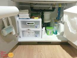 Add storage space under your kitchen sink by adding hooks for cleaning  tools or whatever else