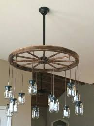 how to make a wagon wheel chandelier image of wagon wheel chandelier small wagon wheel chandelier downlights