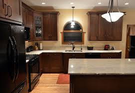 ivory kitchen cabinets with dark wood floors quicua com gorgeous modern kitchen with black appliances