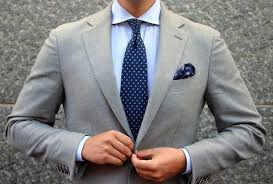 Wear a DARK BLUE tie, it will suit with the light blue shirt most. I wear  this combination very often.