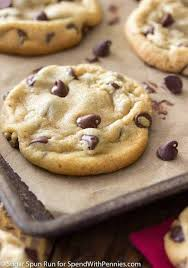 a chocolate chip cookie on a baking sheet