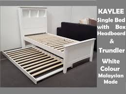 kaylee single bed with box headboard pull out trundler bed on wheels in white