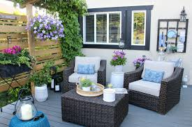 Patio furniture decorating ideas Outdoor Living Sitting Area On Patio With Two Oversized Patio Chairs Clean And Scentsible Outdoor Living Summer Patio Decorating Ideas Clean And Scentsible