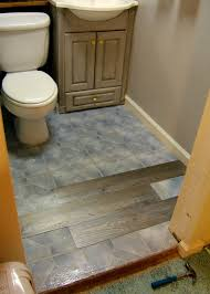interior installing floating vinyl plank flooring over ceramic wall tiles for small and narrow bathroom spaces with old and vintage oak wood vanity ideas