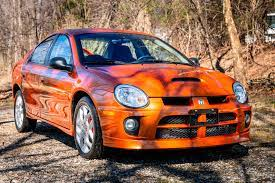 2005 Dodge Neon Srt 4 Has Just 2 900 Miles Rare Orange Blast Paint Carmojo The Range Topping Neon Is Powered By A Turboc Beautiful Cars Srt Amazing Cars