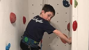 dad builds diy climbing wall in