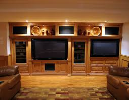 cool entertainment center ideas in traditional family room with ceiling lighting and leather sofas also a cabinets and wood flooring plus wainscoting
