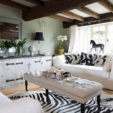 country living room with faux zebra skin rug decorating with animal prints decorating ideas