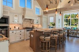 beach style kitchen tile backsplash white cabinets metal and wood bar stools