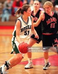 Roseau's Megan Taylor drives around Monticello's Mandy Jepson for ...
