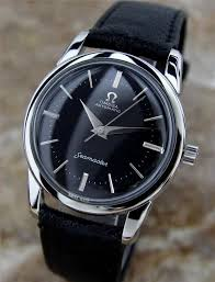 17 best ideas about omega watch omega bond omega men s omega wristwatch black face silver bezel and black leather