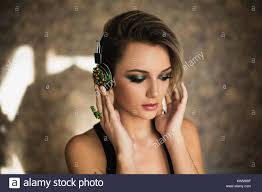 lovely with tanned skin and white hair listening to on headphones female beauty portrait of a beautiful makeup enjoying good