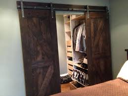 Two piece of dark brown old wood sliding barn doors with union two piece of  dark