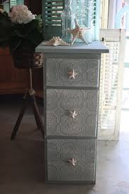 Loveable Small Nightstand Design With Wall Papered Drawers In Soft Grey  Color
