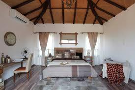 bedroom furniture design ideas. Hakuna Matata: Rustic Bedroom By Mahesh Punjabi Associates Furniture Design Ideas
