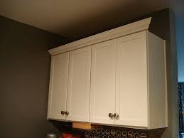 how to put trim on top of cabinets cintronbeveragegroup com