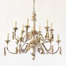 italian wood and iron chandelier with painted silver finish decorated with iron leaves and wood tassels