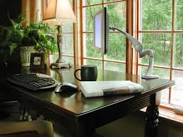 elegant home office interior design ideas with dark brown wooden office table and mounted computer screen chair elegant home