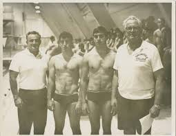 Coaches Charlie Smith and Charles Silvia with SC swimmers David Roach and  Bill Vogler - College Archives Digital Collections - Springfield College  Digital Collections