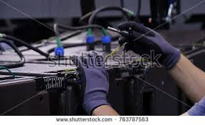 lighting technician. Lighting Technicians Intstalling Professional Equipment. Man Engineer Is Working On A Device Technician I