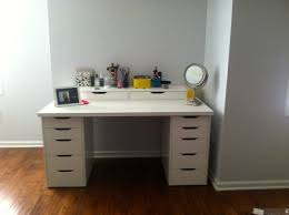 furniture rectangle white wooden makeup vanity with drawers on brown wooden floor connected by grey