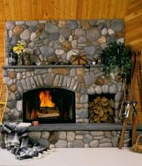 Wood cabin with River Rock fireplace and wood storage.
