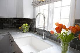gray kitchen subway tiles with white cabinets