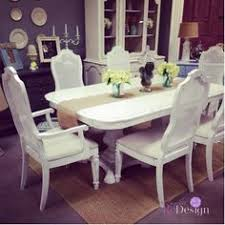 elegantly distressed dining table with linen seats