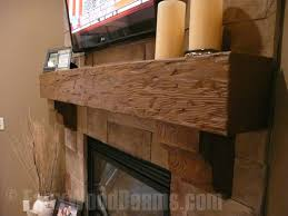 a faux wood mantel provides a place for photos and knick knacks as well as