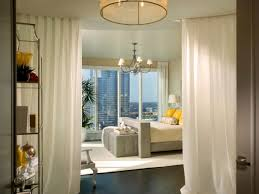 Ottomans For Bedroom Bedroom Awesome Chandelier Above Grey Bed And Tufted Ottomans On