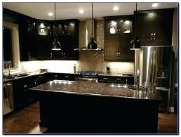 backsplash with black countertops for dark cabinets epic kitchen with dark cabinets within designing home inspiration