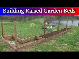 building raised beds and fence posts