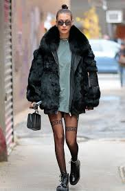 in strike opposition to ri ri s style bella takes a more tonal approach to faux fur by investing in a classic black coat this satorical investment can be