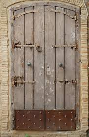 Medieval Doors texture old medieval door with rusty bottom ruined doors 1852 by xevi.us