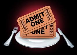 two admit one tickets on top of dinner plate pigeon forge dinner shows