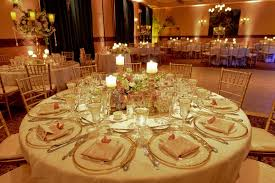 wedding table centerpiece with white candles and wine glasses with reception decor also weddings interior